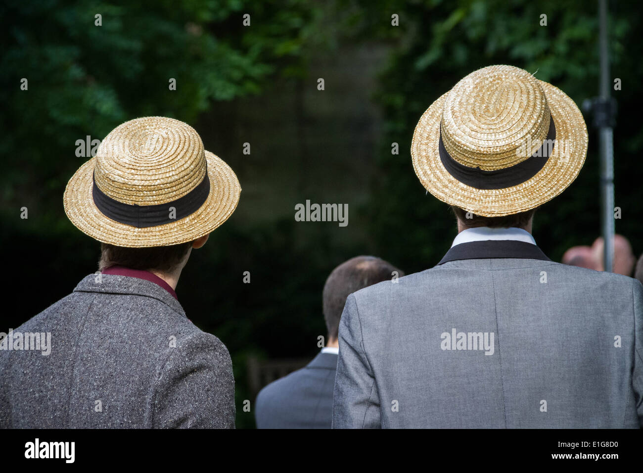 Two Englishman in tweed jackets with straw boater hats. - Stock Image