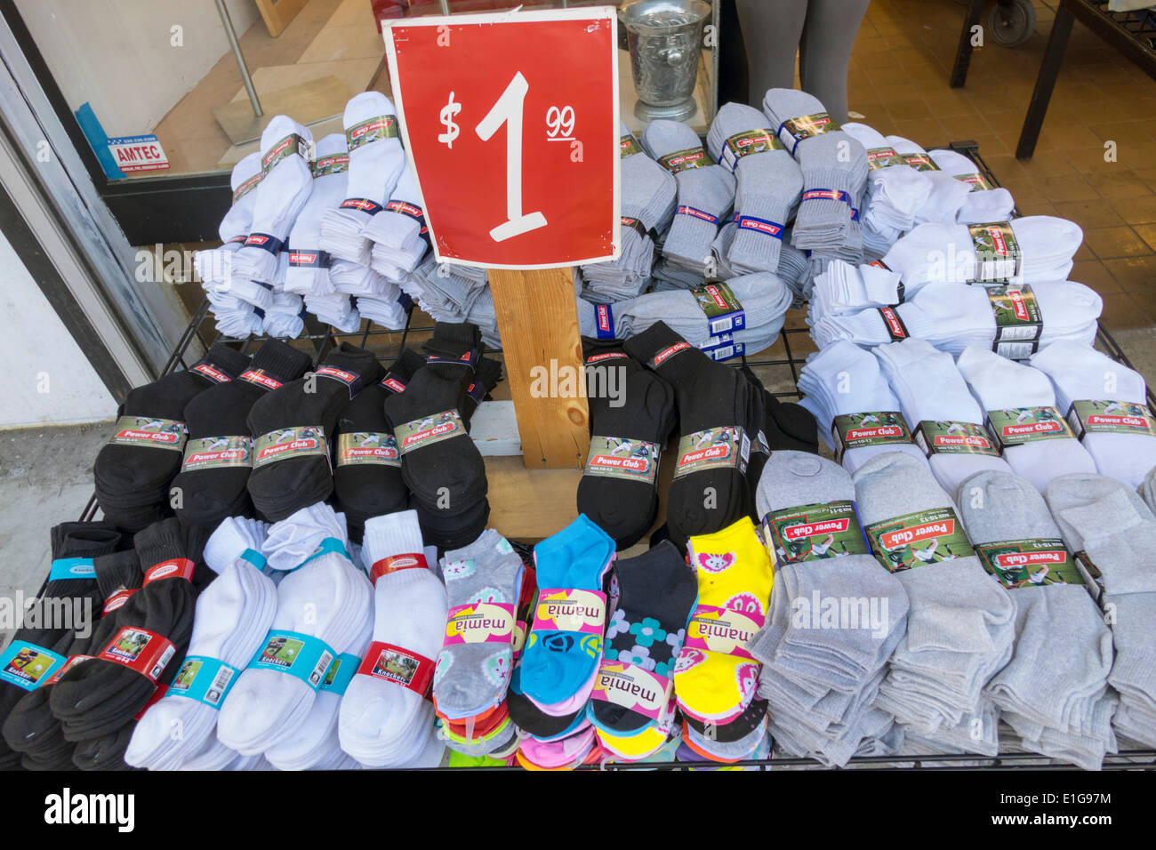 Los Angeles California CA L.A. Downtown shop store retail business shopping sidewalk sale bargain socks pack price $1.99 - Stock Image