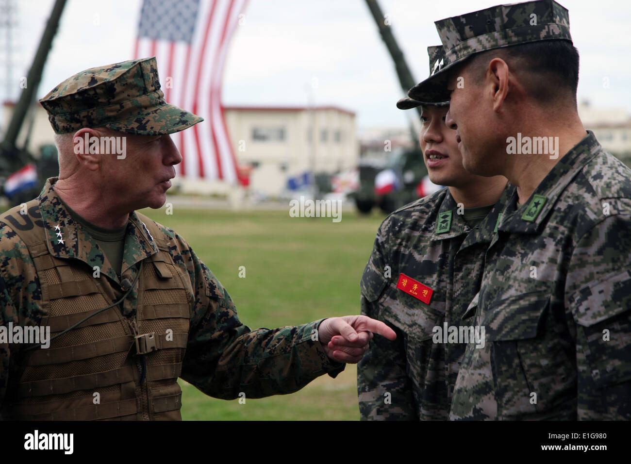 U.S. Marine Corps Lt. Gen. Kenneth J. Glueck, left, speaks with Korean service members before a change of command Stock Photo