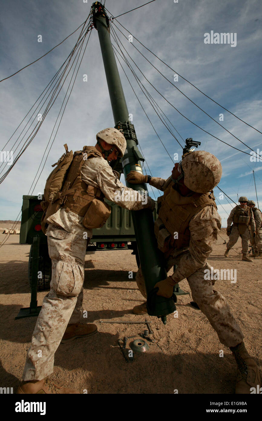 U.S. Marines with Headquarters and Service company, 3rd Battalion, 4th Marine Regiment, (3/4) set up an antenna Stock Photo