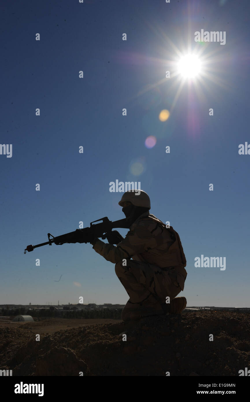 An Iraqi soldier assigned to 1st Company, 1st Battalion, 28th Mechanized Brigade, 7th Iraqi Army Division provides Stock Photo
