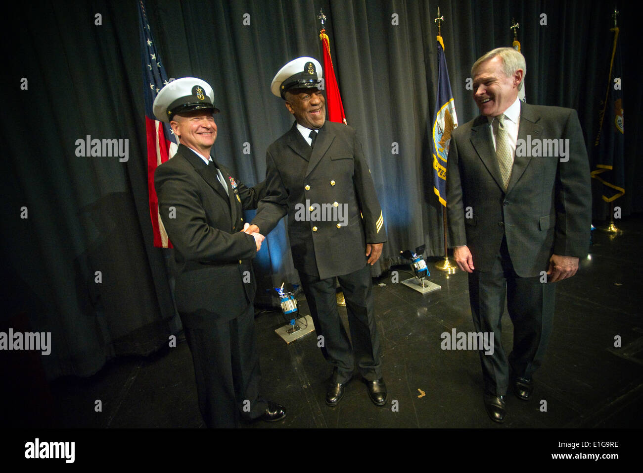 Master Chief Petty Officer of the Navy Rick West, left, and Secretary of the Navy Ray Mabus congratulate Honorary Stock Photo