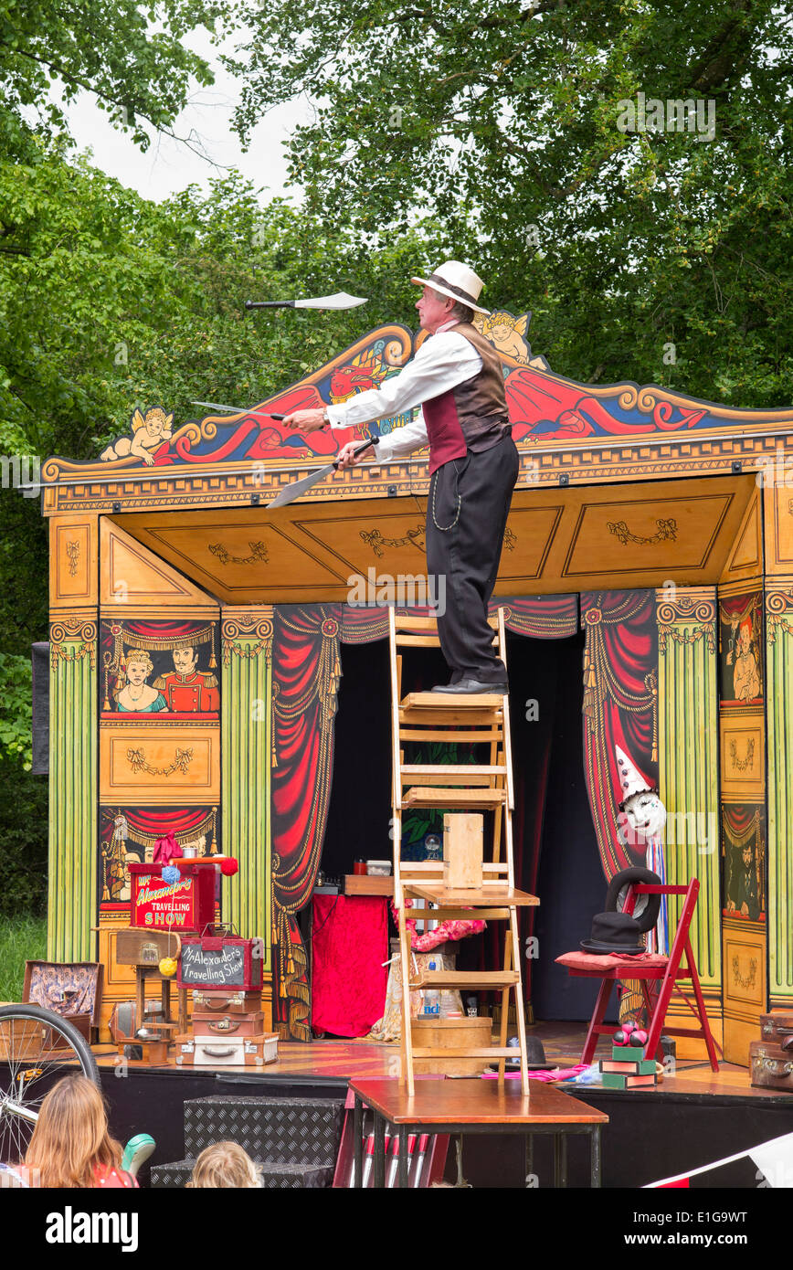 Travelling showman performing at a nostalgic vintage show. Wiltshire, England - Stock Image