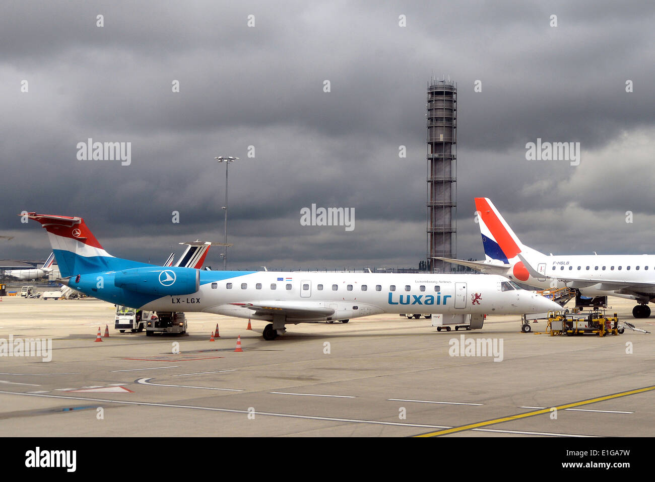 Embraer ERJ-145LU airplane of Luxair Roissy Charles-de-Gaulle international airport terminal G France - Stock Image