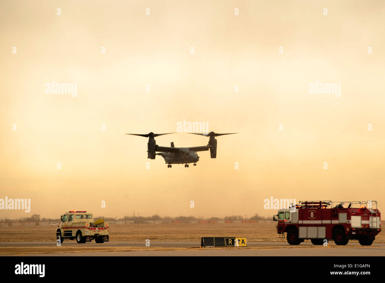 A U.S. Air Force CV-22 Osprey tiltrotor aircraft performs an in-flight emergency landing during exercise Emerald Warrior at Can - Stock Image
