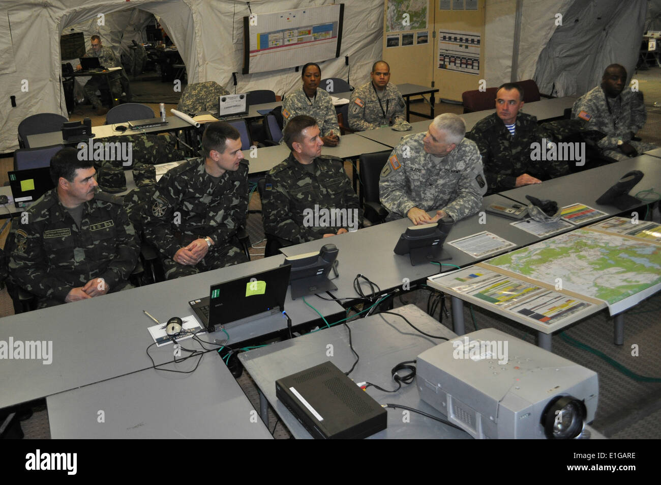 U.S. Army Col. Keith Sledd, director of the Saber Strike 11 exercise, third from right, briefs the Ukranian Land Forces delegat - Stock Image