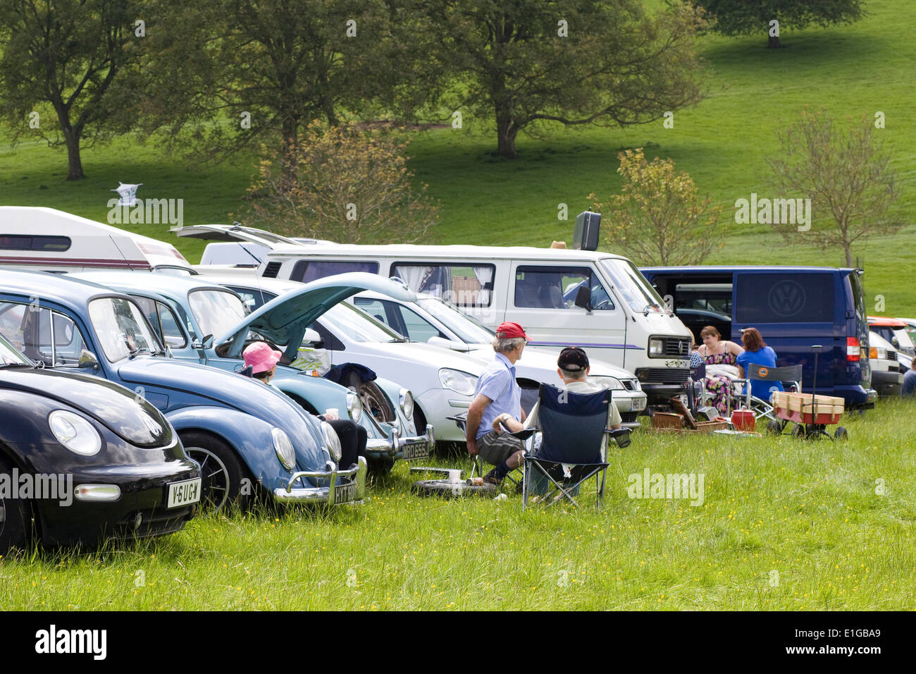 People Picnicking at a Volkswagen Show in England - Stock Image