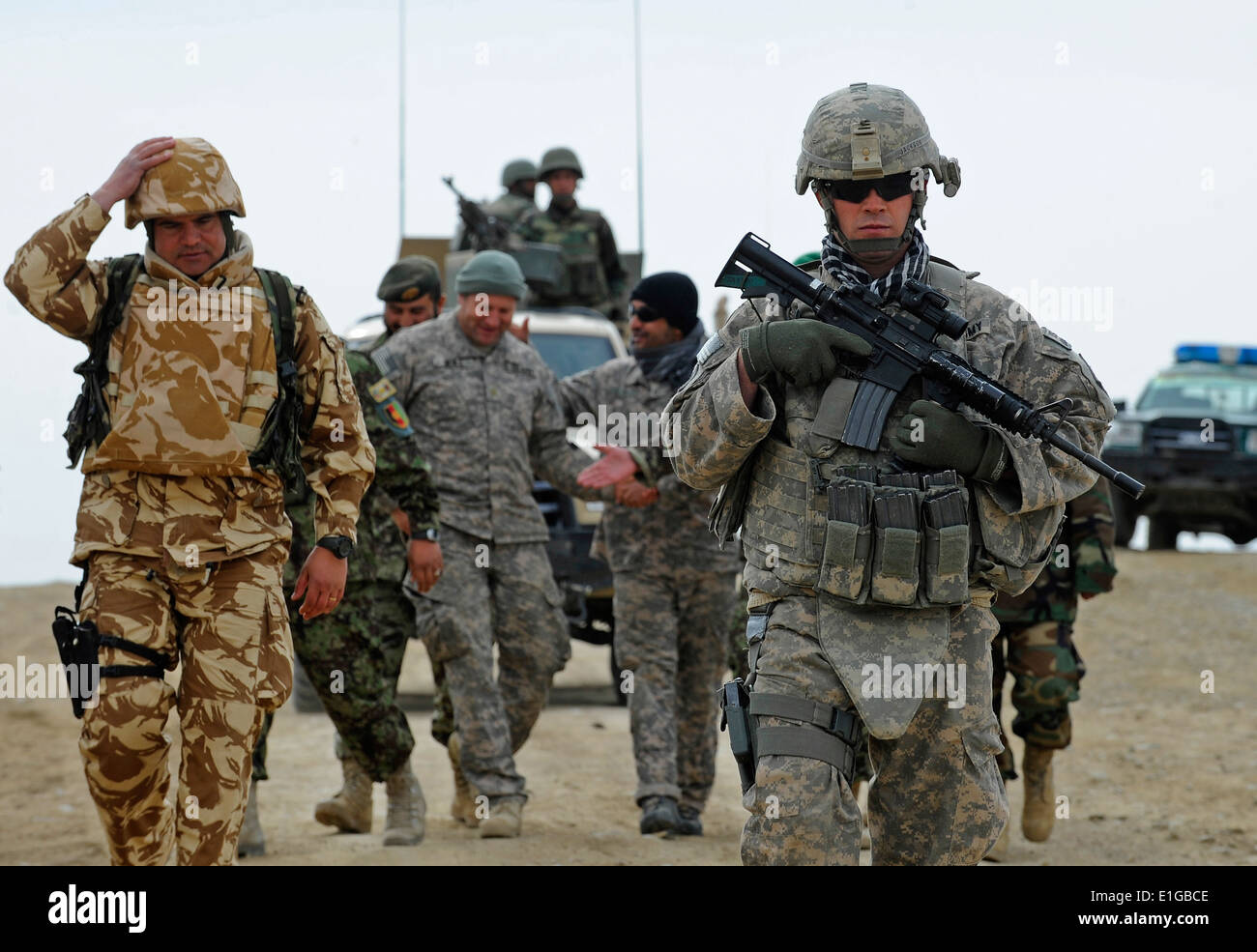 U.S. Army Pfc. Brian Jackson stands guard as members of the Zabul Provincial Reconstruction Team (PRT) and International Securi - Stock Image