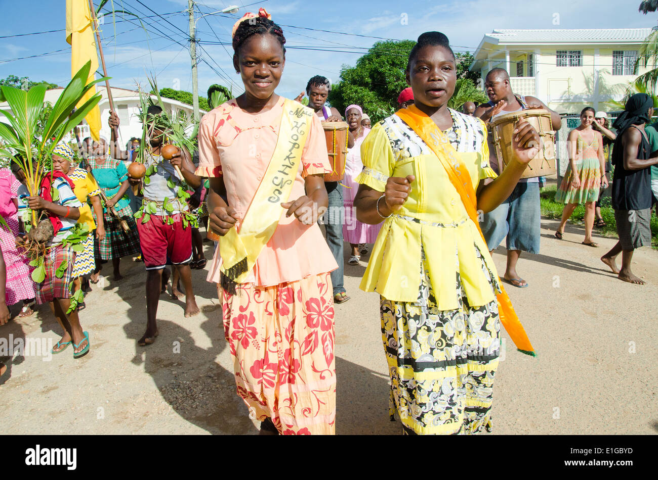 Hopkins Village, Belize, - November 19, 2013: Miss Hopkins 2013 heads up the parade as a procssession of singers, - Stock Image