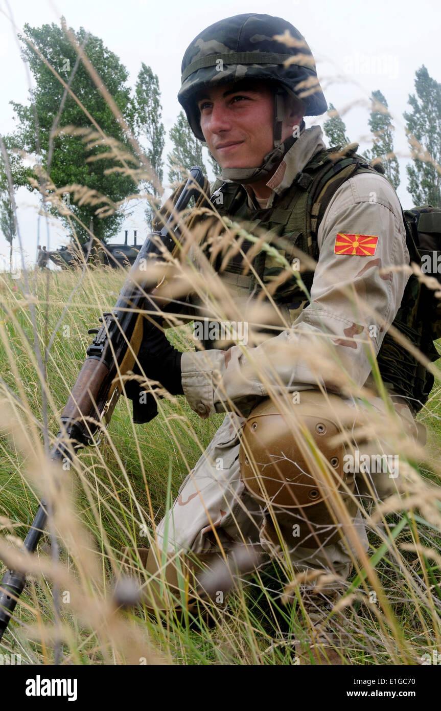 110611-N-FV216-174: SHIROKILAN, Ukraine (June 11, 2011) - A Macedonian marine provides extra countermeasure support during a jo - Stock Image