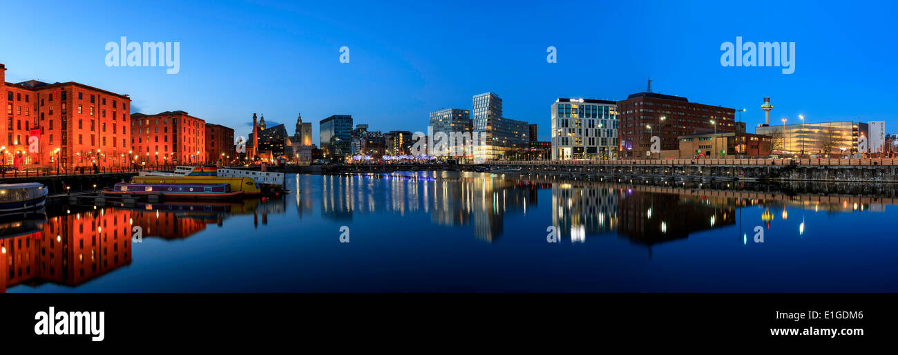 panoramic view of Liverpool skyline reflected in river mersey at albert dock - Stock Image