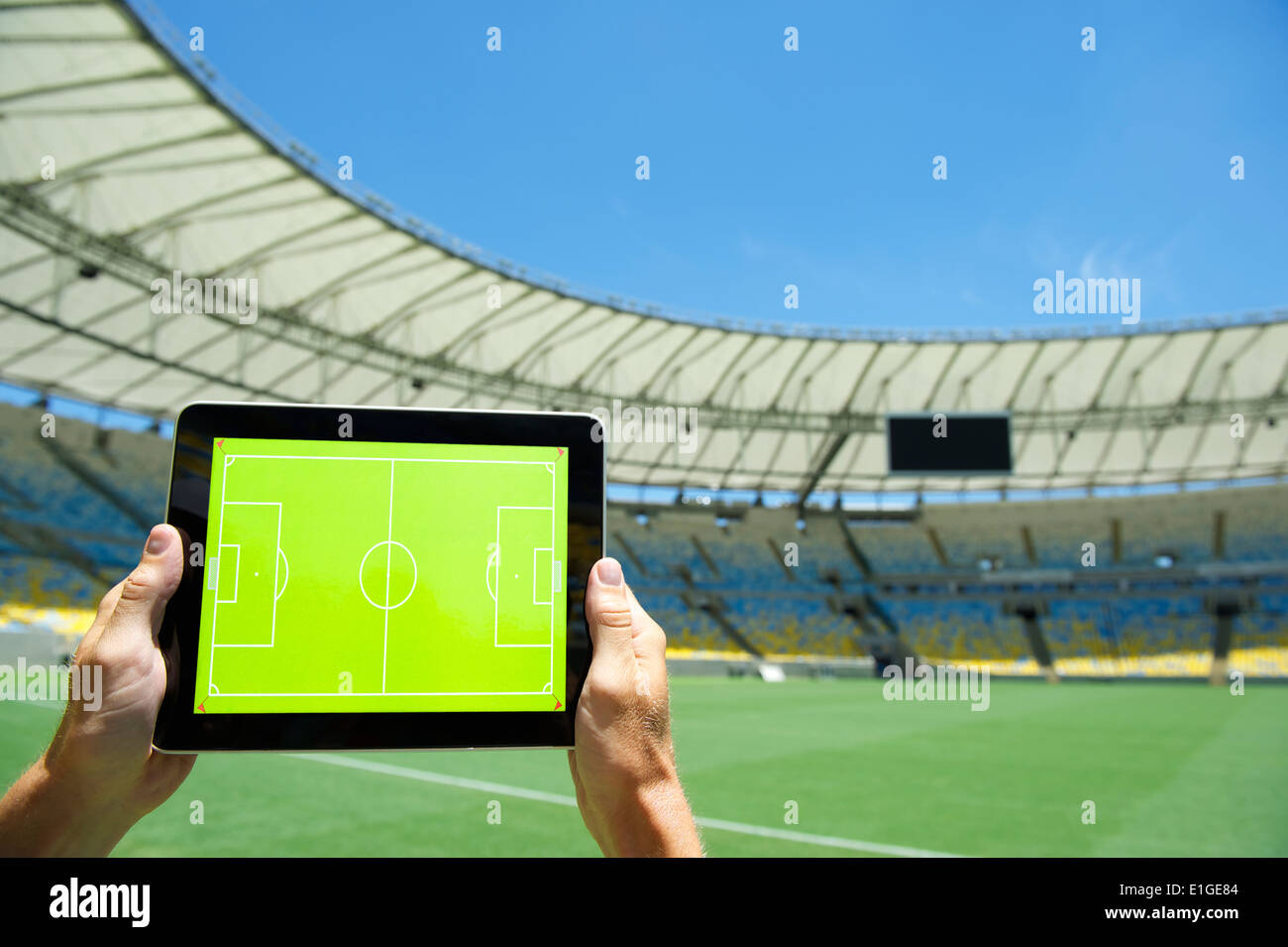 Hands Holding Blank Tactics Board In Front Of Soccer Field At Football Stadium Rio De Janeiro Brazil