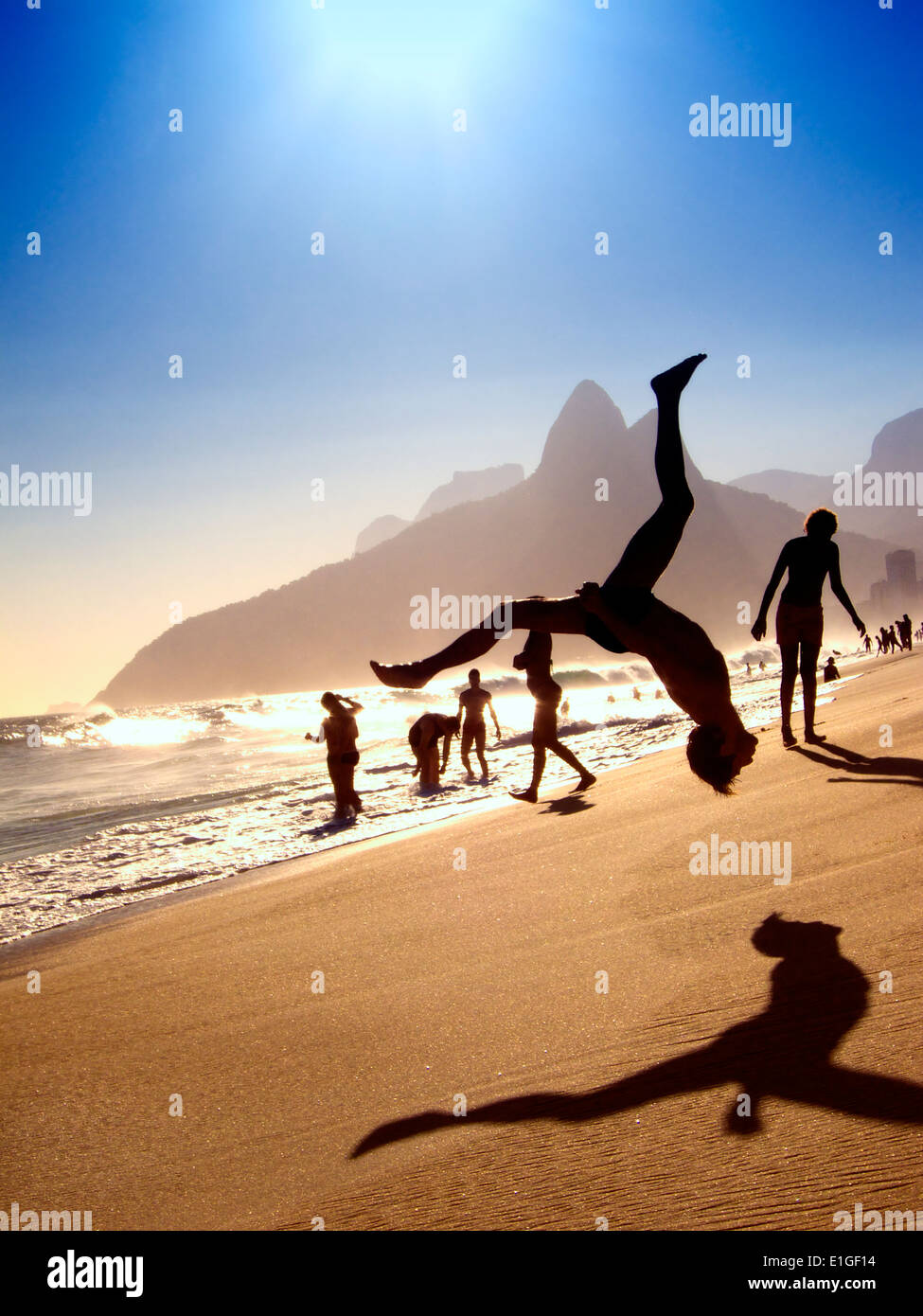 7a7d8144878c2a Silhouette of someone doing a flip above sunset beach scene at Ipanema Beach  Rio de Janeiro Brazil