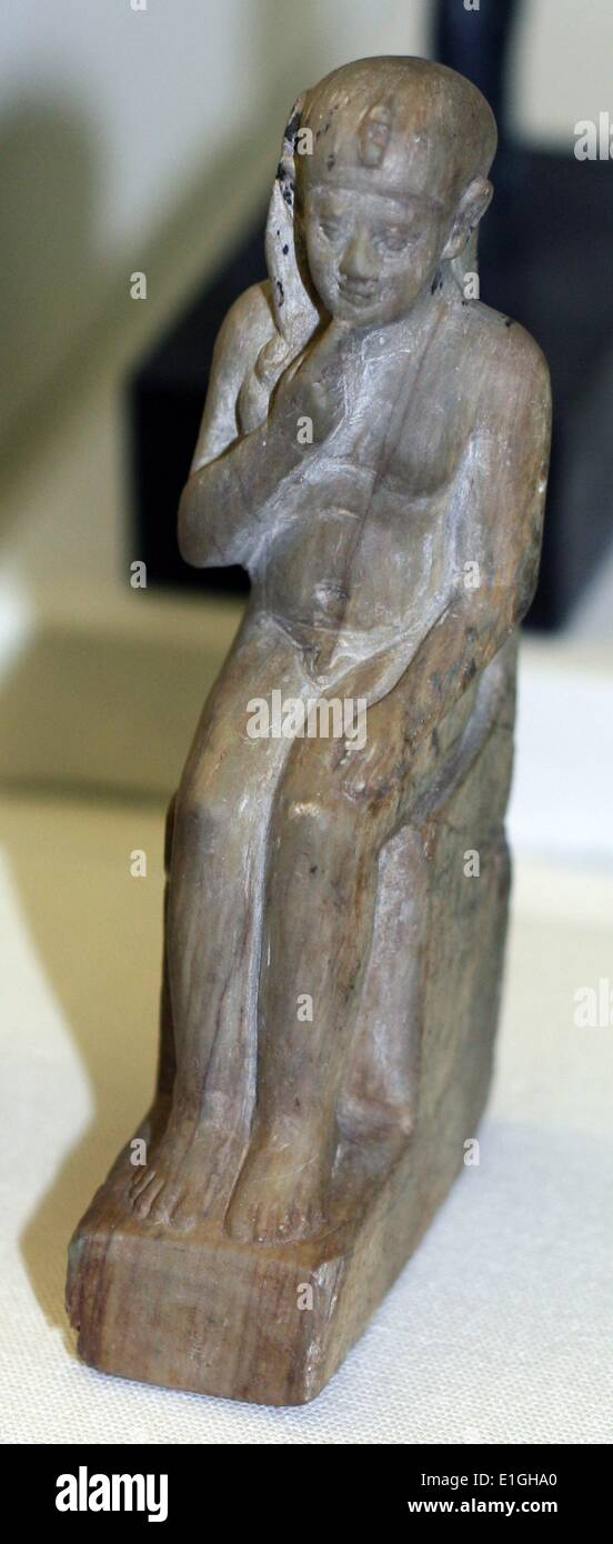 Seated figure of Harpocrates.  Stone.  Late Period 600-100 B.C. - Stock Image