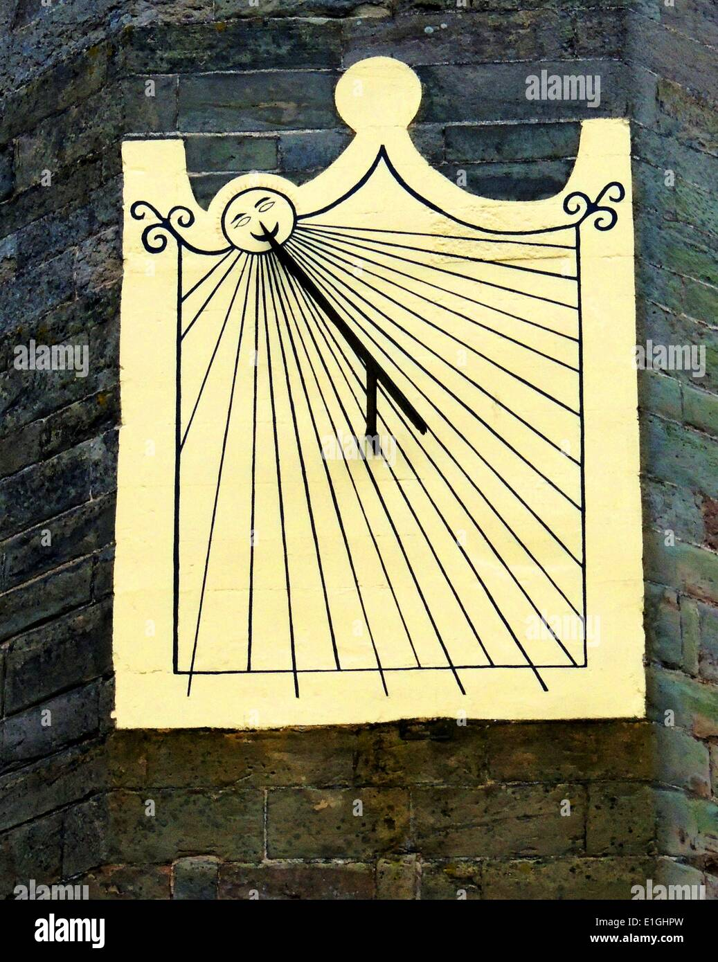 Sundial mounted on the entrance tower at Warwick Castle, England. - Stock Image