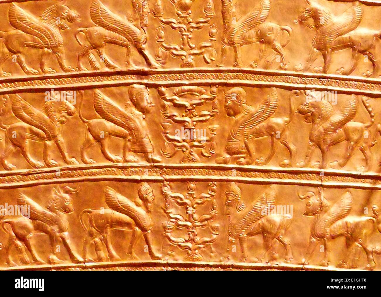 Plaques with winged creatures approaching stylized trees.  Gold, from Northwestern Iran, 8th-7th century B.C. - Stock Image