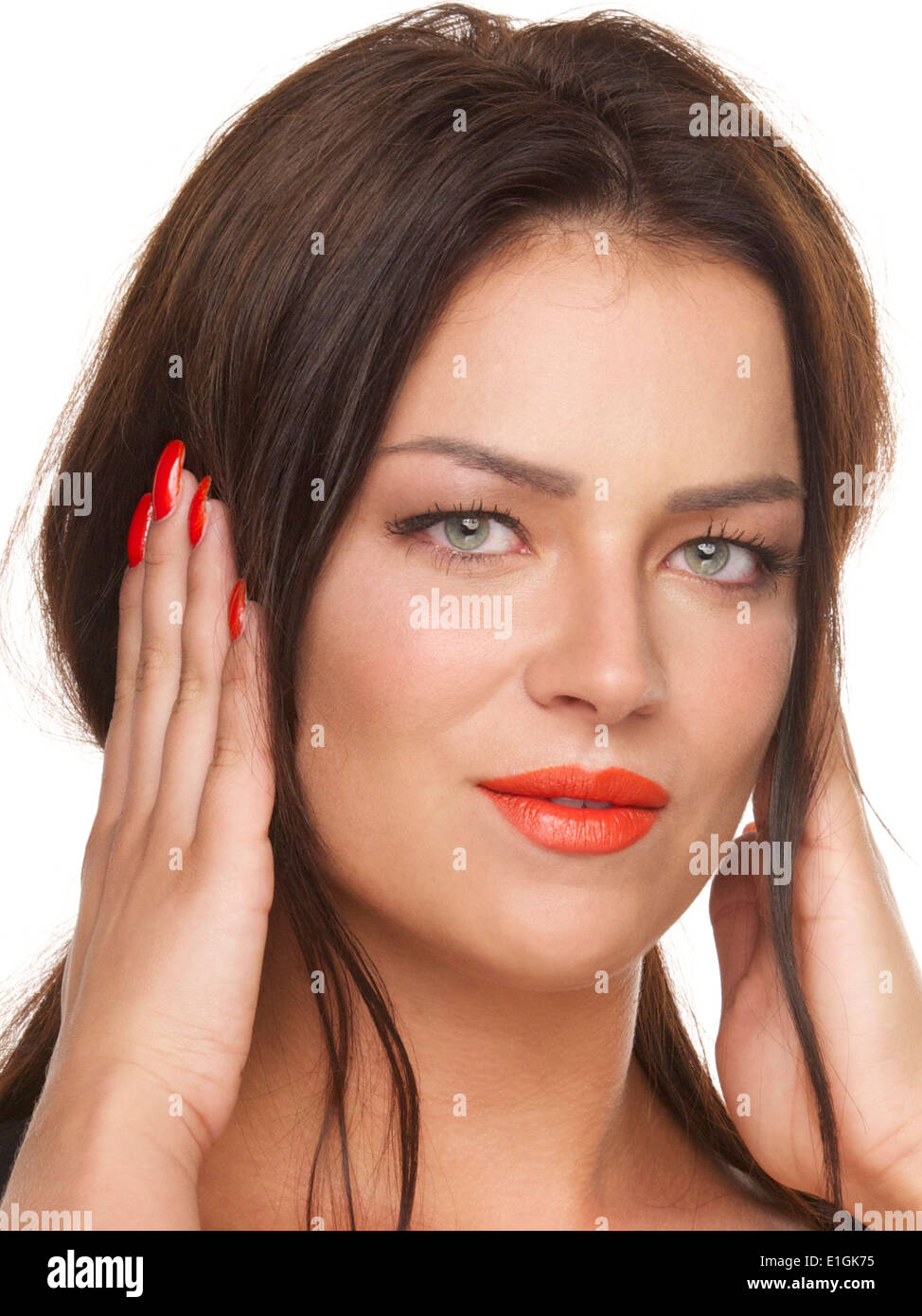 Pretty girl with red lipstick, ears covered with hands, three wise monkeys series. - Stock Image