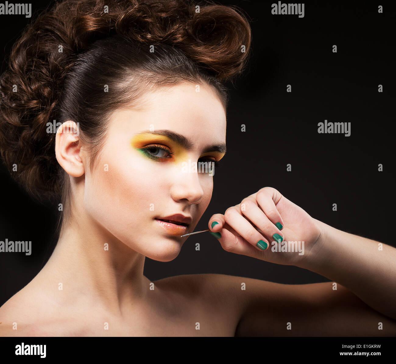 Ambition. Glamor. Sophisticated Lady Fashion Model with Needle - Stock Image