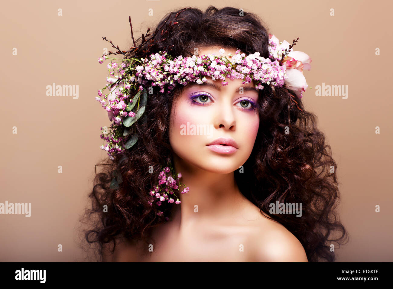 Luxuriant. Femininity. Fashion Model with Classic Wreath of Flowers - Stock Image