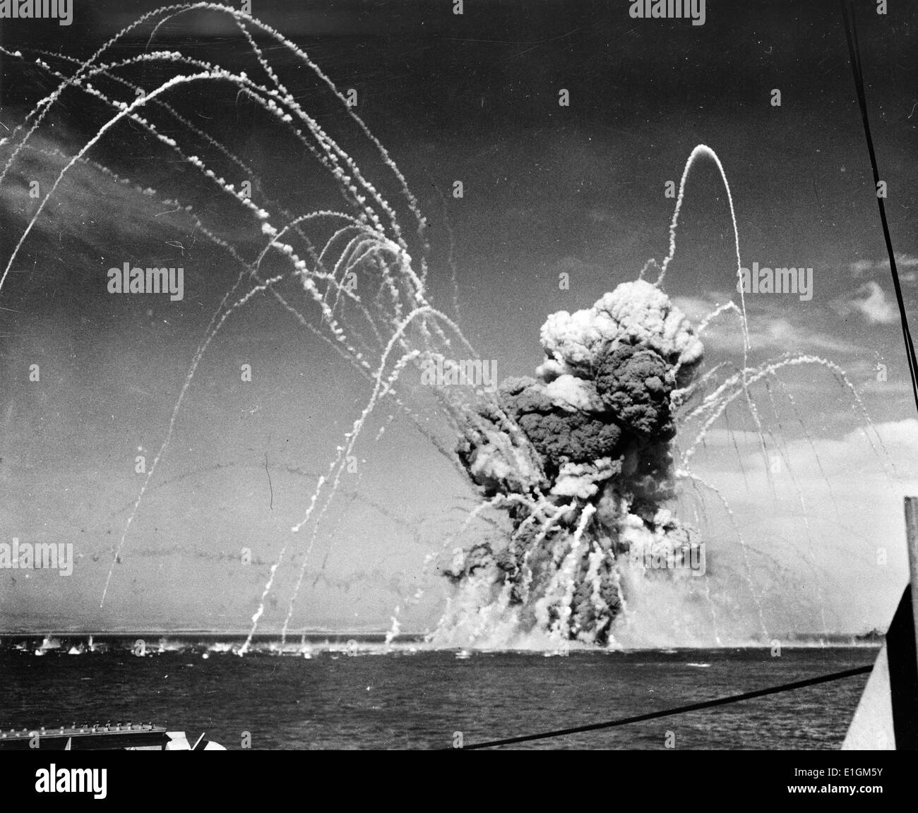 American cargo ship exploding after being hit by Nazi dive bombers in an air raid on a convoy in the invasion of Sicily - Stock Image