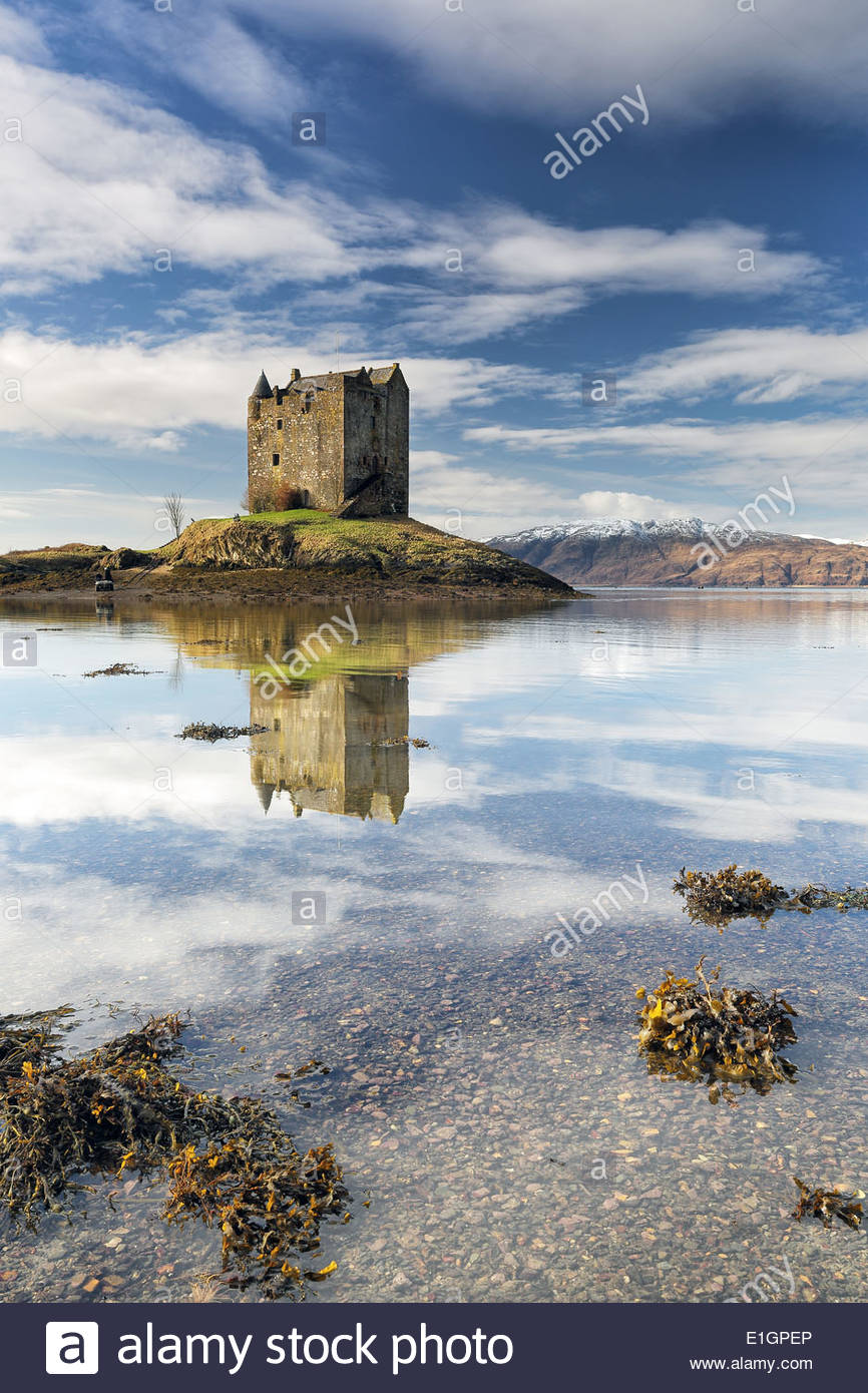 Castle Stalker reflecting on Loch Linnhe in the west coast of Scotland - Stock Image