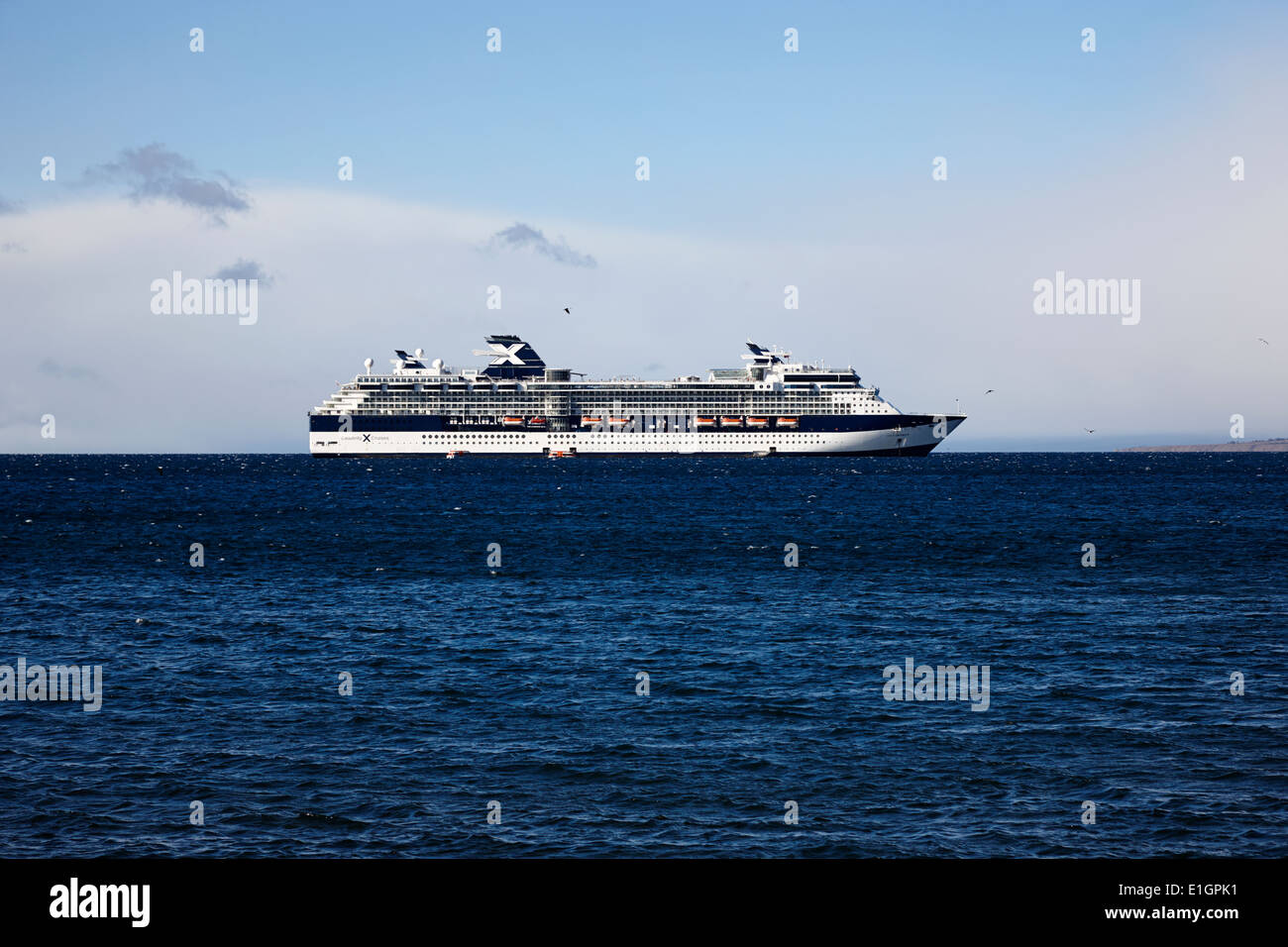 large celebrity infinity cruises cruise ship anchored offshore in shallow water port Punta Arenas Chile - Stock Image