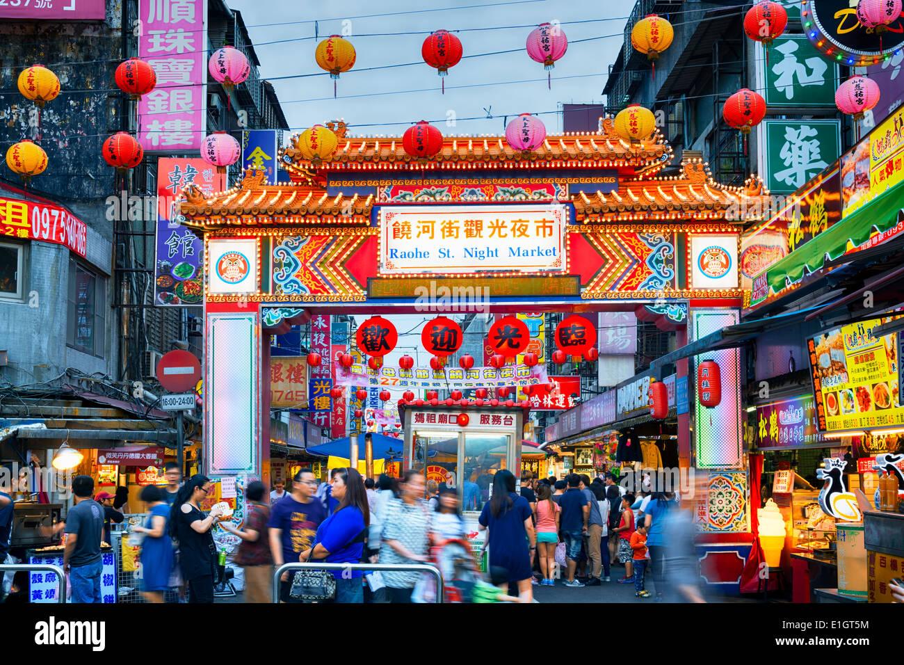 Entrance of Raohe Street Night Market in Taipei. Stock Photo