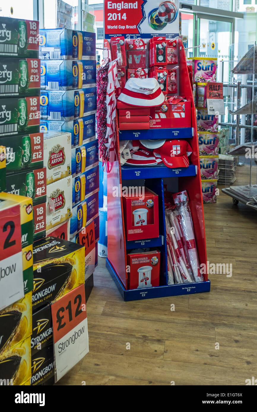 Rack of Football World Cup 2014 merchandise in the Co-op store in Greenwich, London, UK - Stock Image
