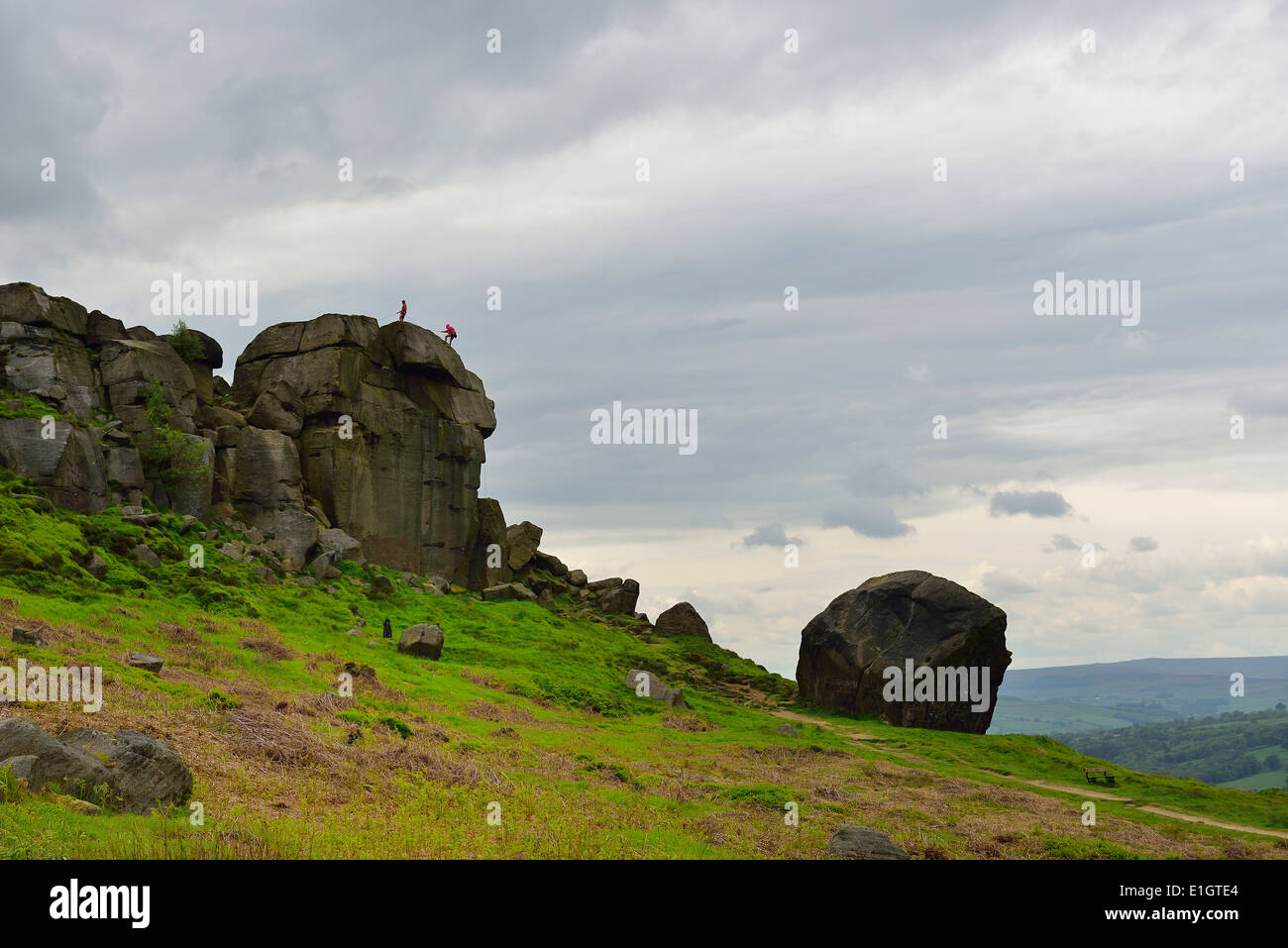 Abseiling down the Cow and Calf rock face on Ilkley Moor West Yorkshire England UK Stock Photo