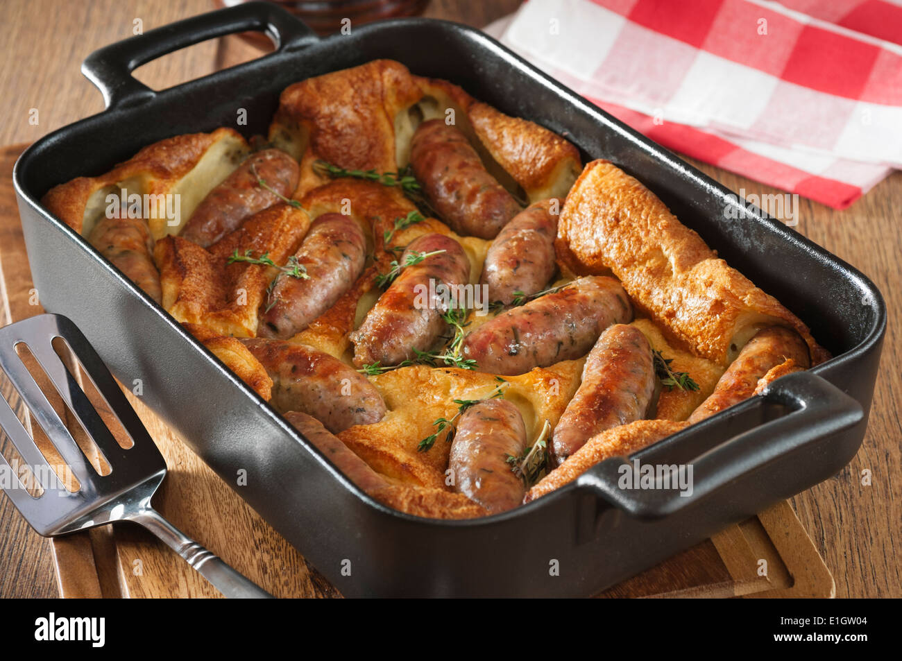 Toad in the hole. Sausages cooked in batter. UK Food - Stock Image