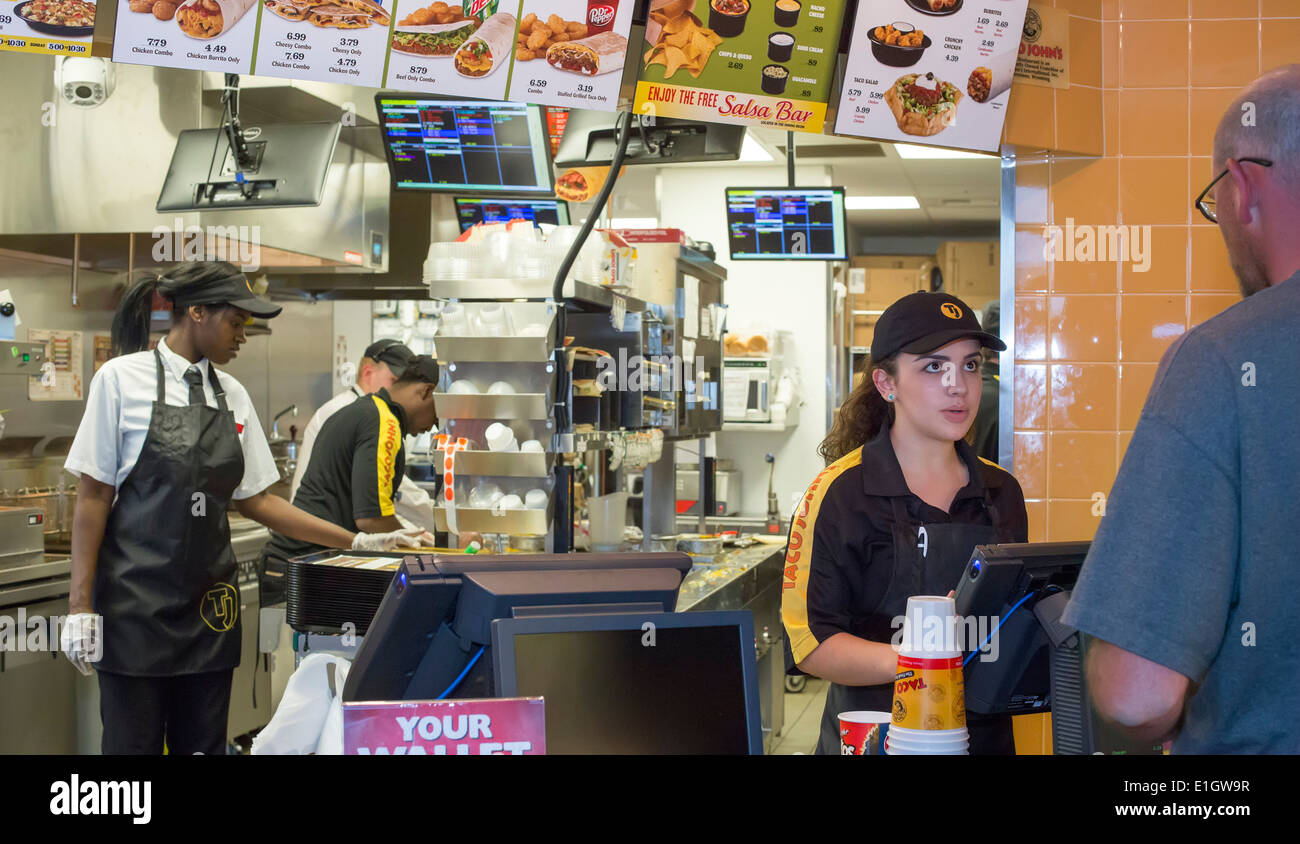 Watford City, North Dakota - Taco John's fast food restaurant, which is paying a $16-$20 starting wage for new hires. - Stock Image