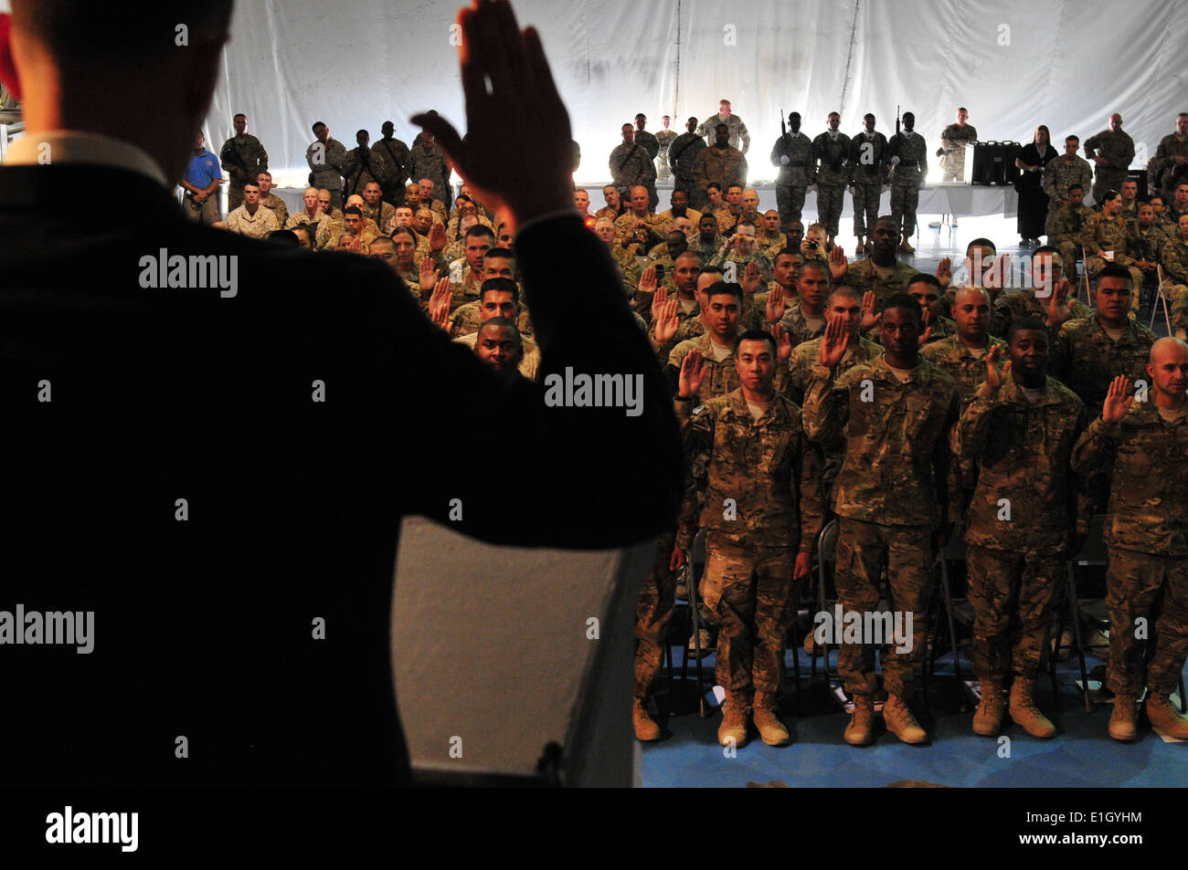 U.S. Service members recite the Oath of Allegiance given by Robert Daum during a naturalization ceremony at Bagram Air Field, A - Stock Image