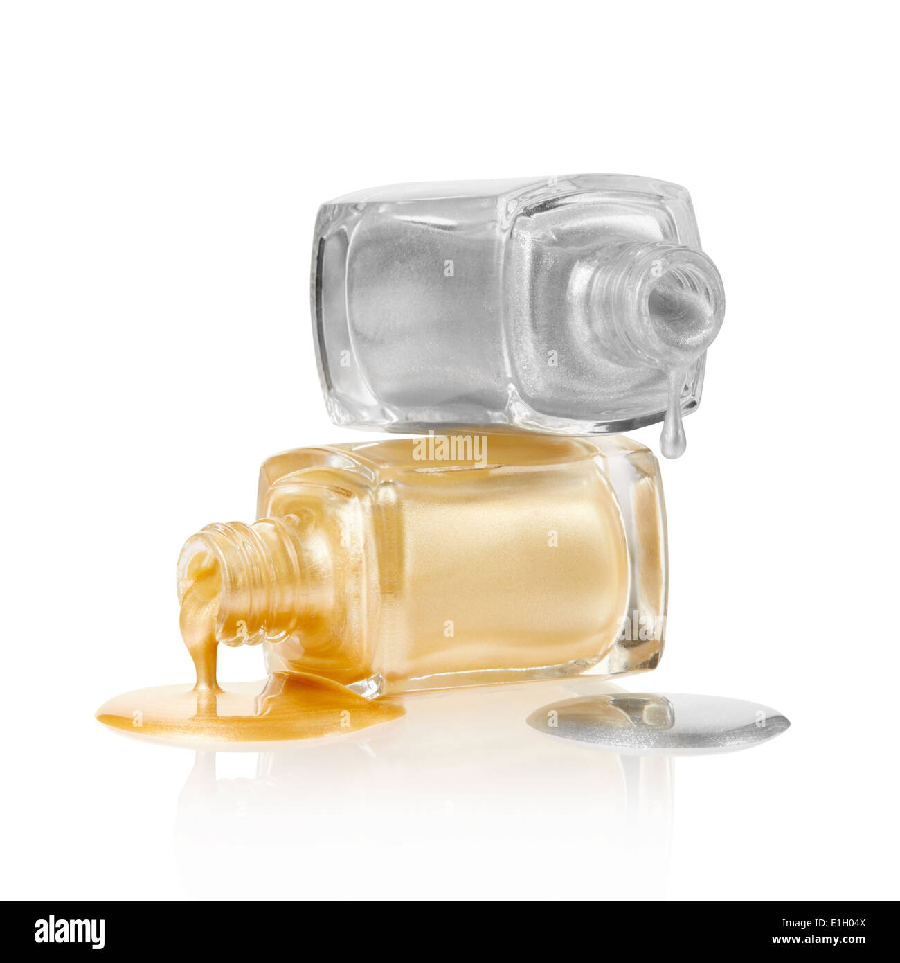 Gold and silver nail polish spilled Stock Photo: 69829450 - Alamy