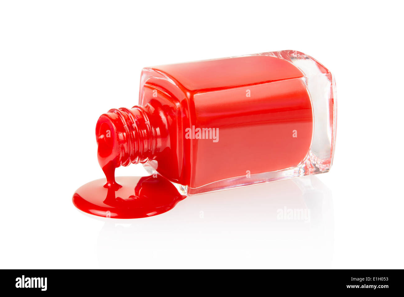 Red nail polish spilled - Stock Image