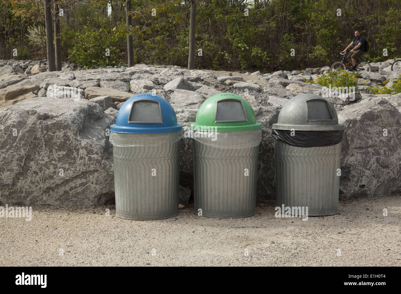 Trash and recycling receptacles in Brooklyn Bridge Park, Brooklyn, NY. - Stock Image