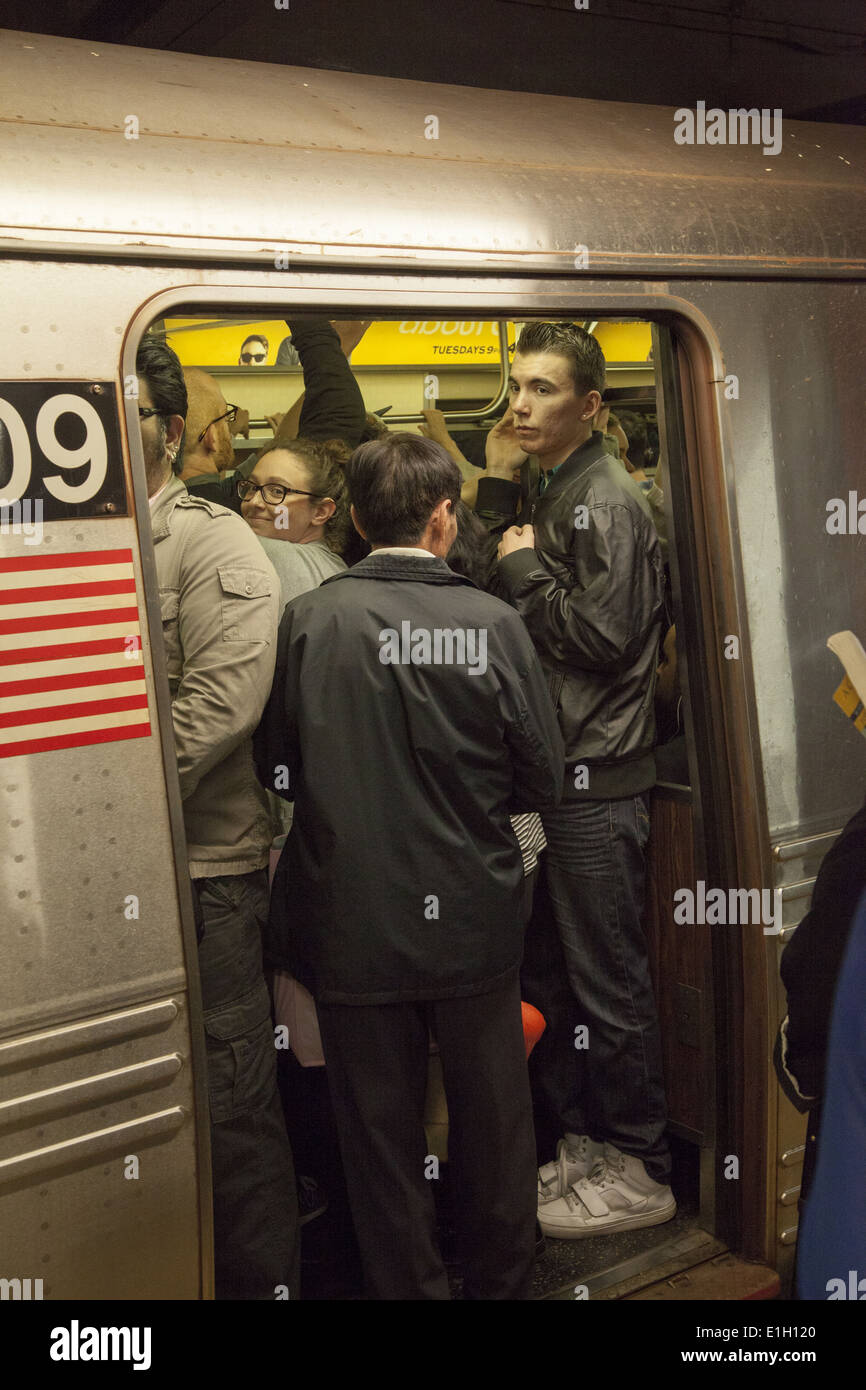 Subway trains and platforms are packed at evening rush hour in Manhattan. Broadway/ Lafayette stop, SOHO. - Stock Image