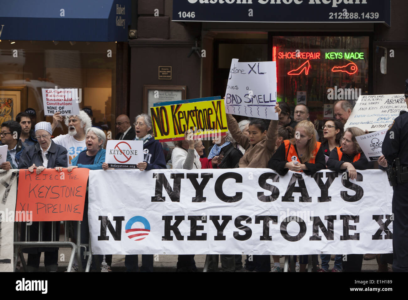 Demonstrators against the approval of the Keystone XL Pipeline on Madison Ave. in NYC waiting for President Obama Stock Photo