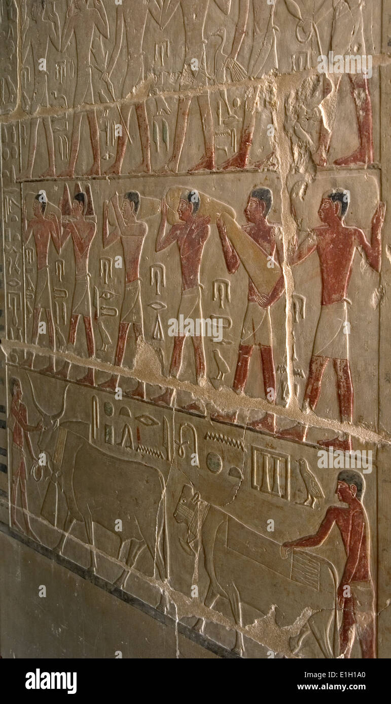 Mastaba of Nefer and Kahay. Polychromed relief depicting porters of offerings. 5th Dynasty. Old Kingdom. Saqqara. Egypt. - Stock Image