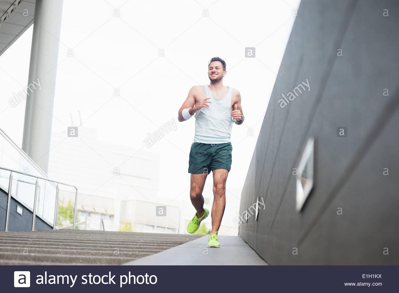 Jogger descending ramp - Stock Image