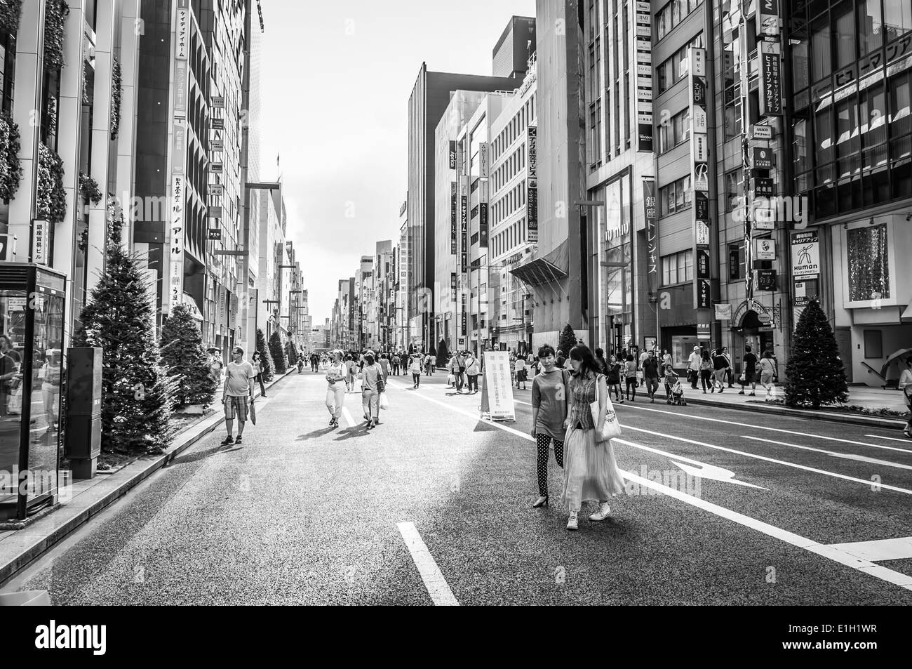 Shoppers wander the streets of Ginza in Tokyo, Japan. Stock Photo