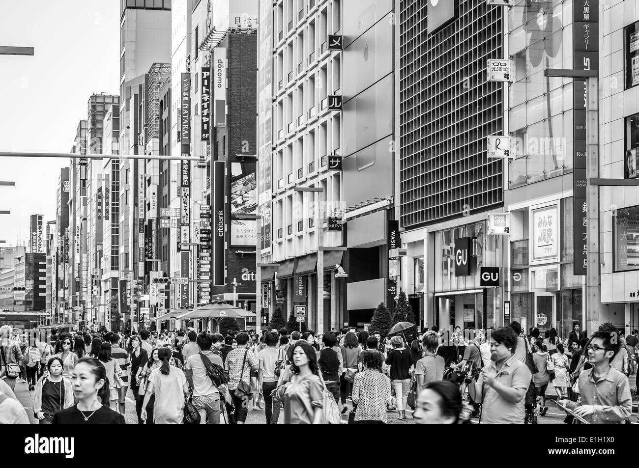 Shoppers wander the streets of Ginza in Tokyo, Japan. - Stock Image