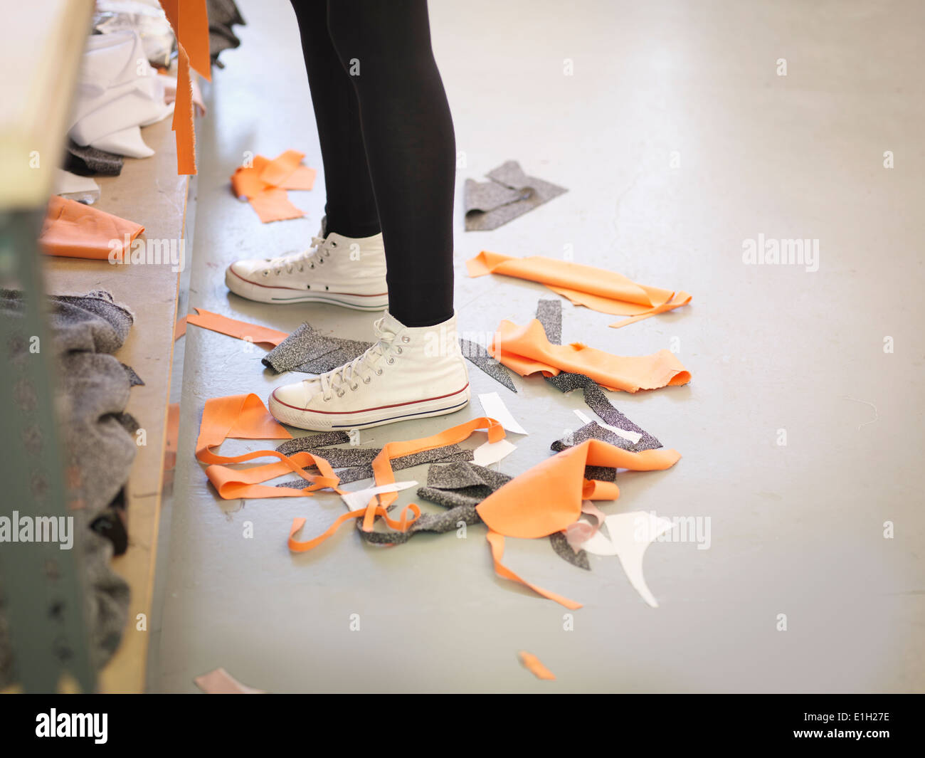 Off-cut material on floor in fashion design studio - Stock Image