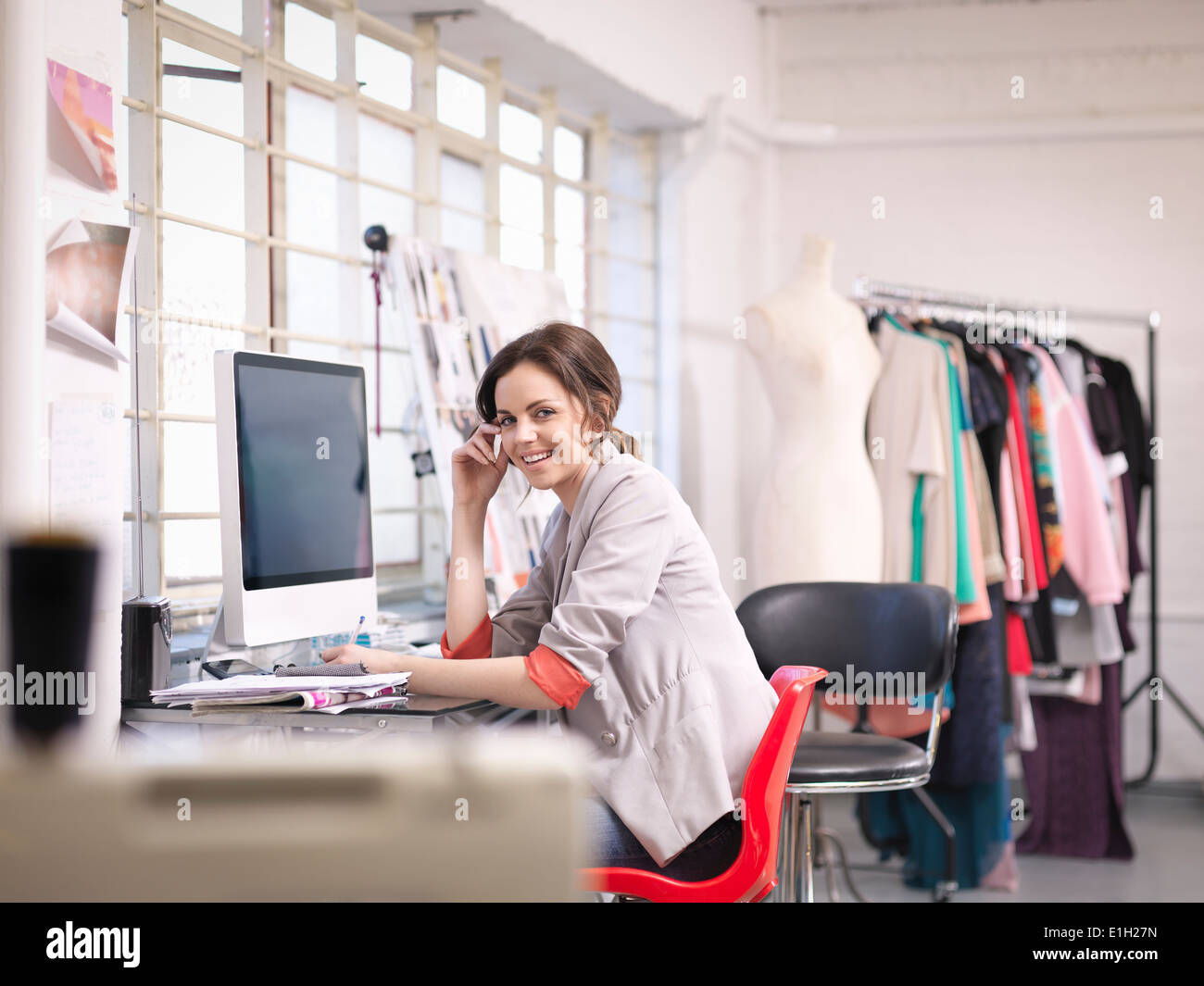 Fashion Designer Working At Computer In Fashion Design Studio Stock Photo Alamy