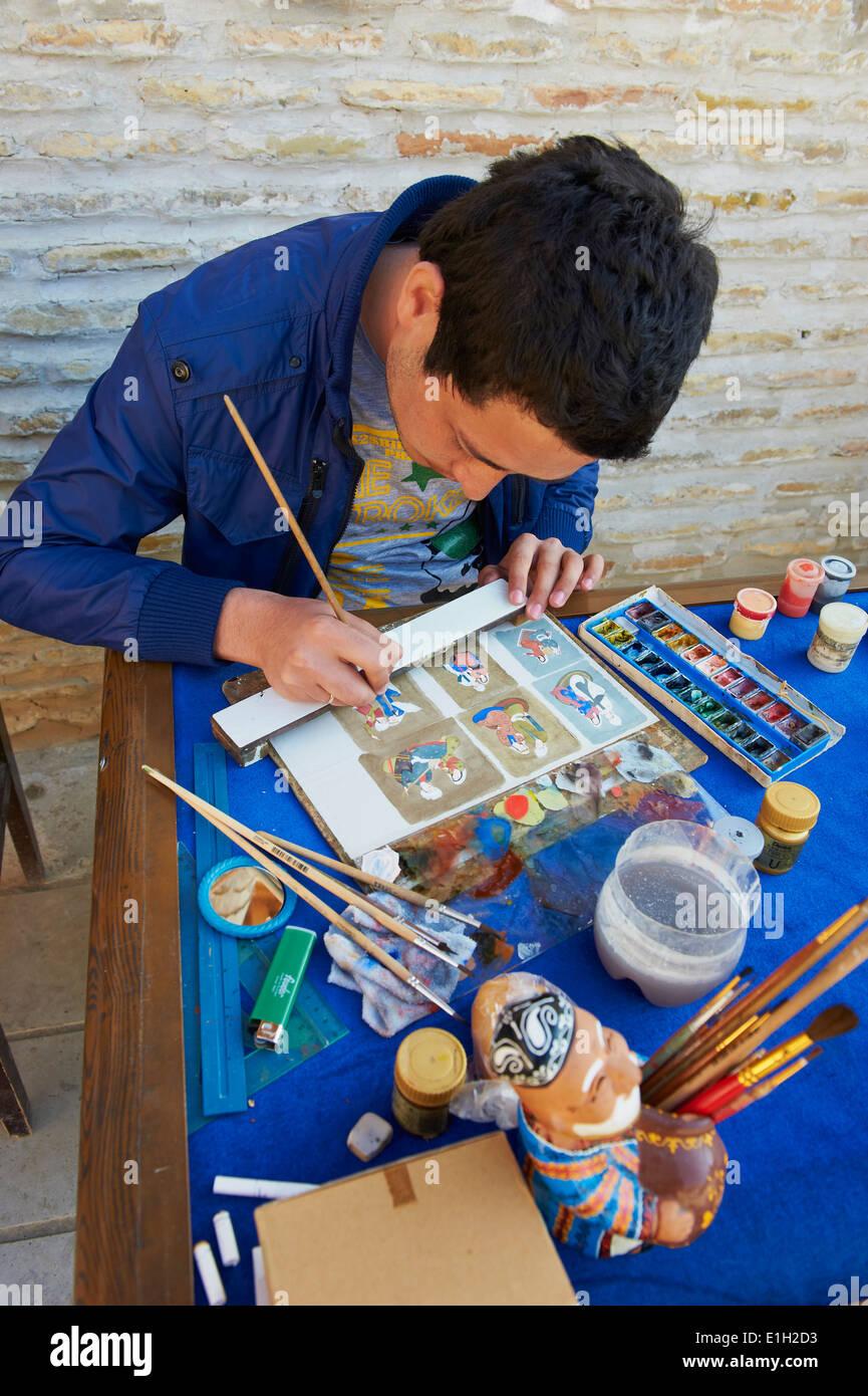 Uzbekistan, Bukhara Unesco world heritage, painter - Stock Image