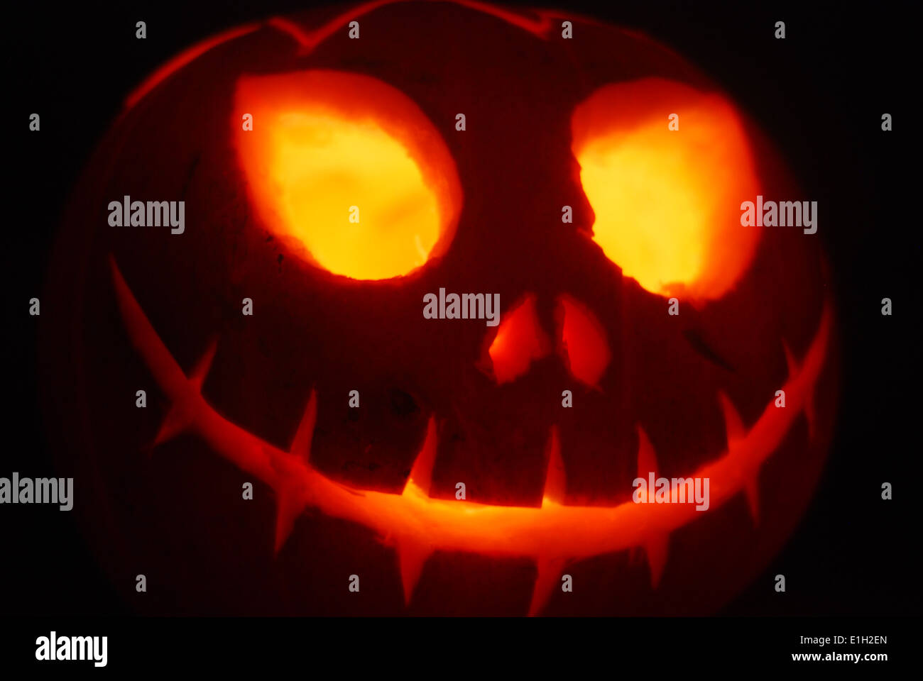 Large Glowing Scary Halloween Pumpkin Face Stock Photo