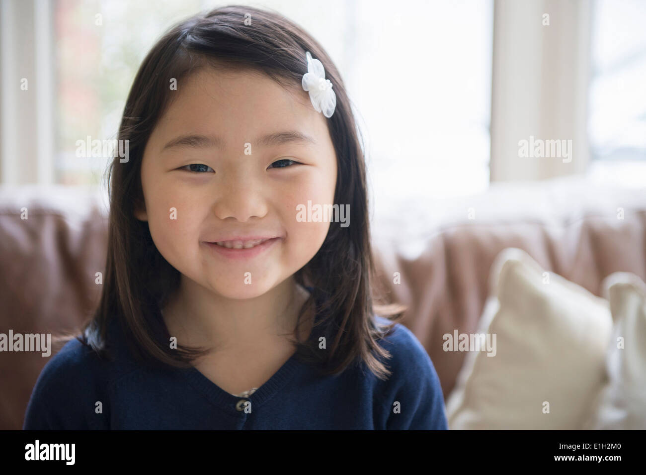 Portrait of young girl in sitting room - Stock Image