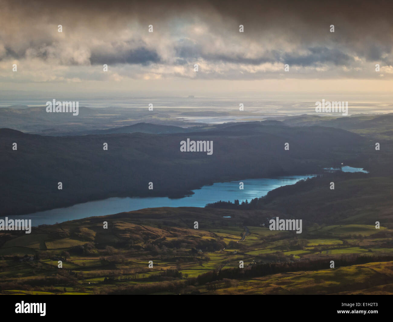 View across Lake Coniston in the Lake District with the sea and Heysham nuclear power station from the Old Man of Stock Photo