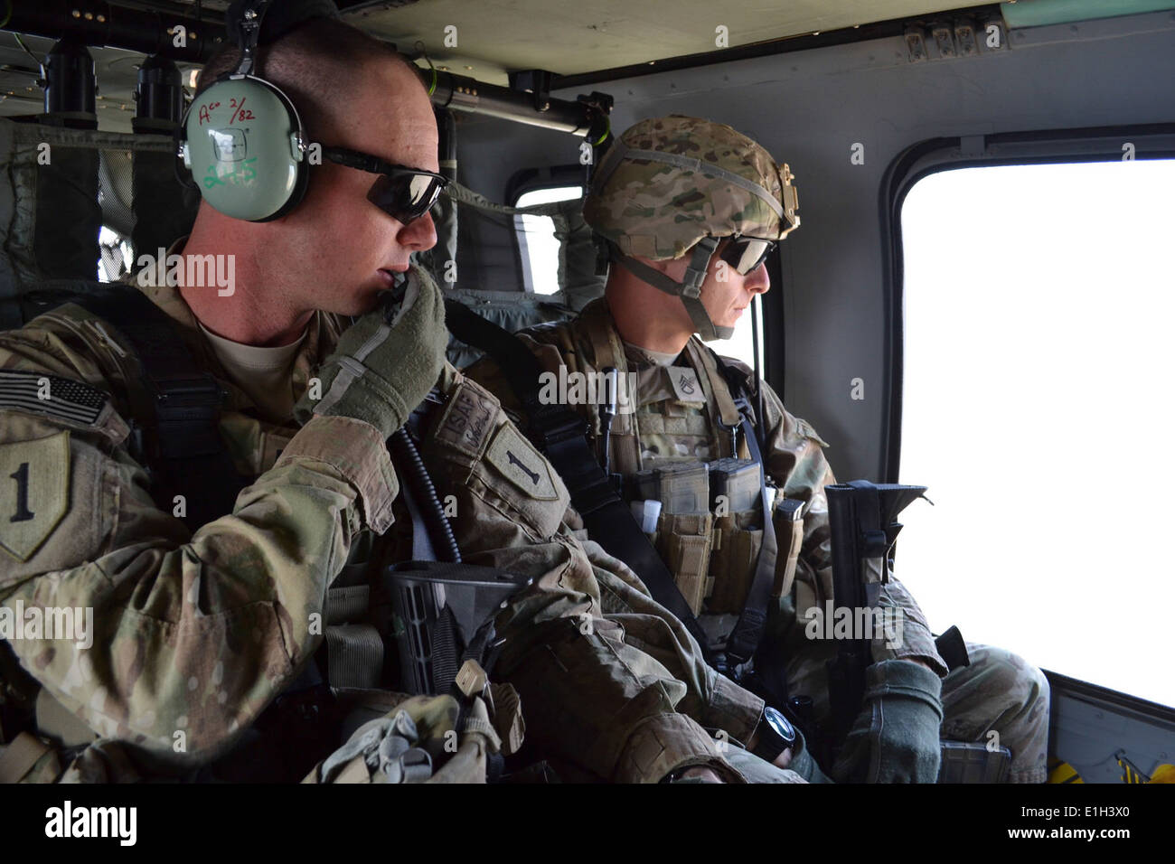U.S. Arm Capt. Tim Black, an intelligence officer, and Staff Sgt. Christopher Lenington, an infantryman, both of Headquarters a - Stock Image