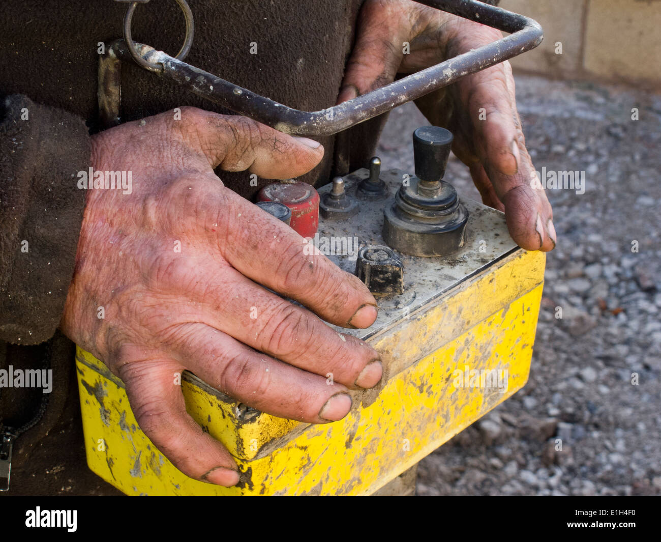 self building house, pouring floor slab, hands of man operating concrete pump remote control Stock Photo