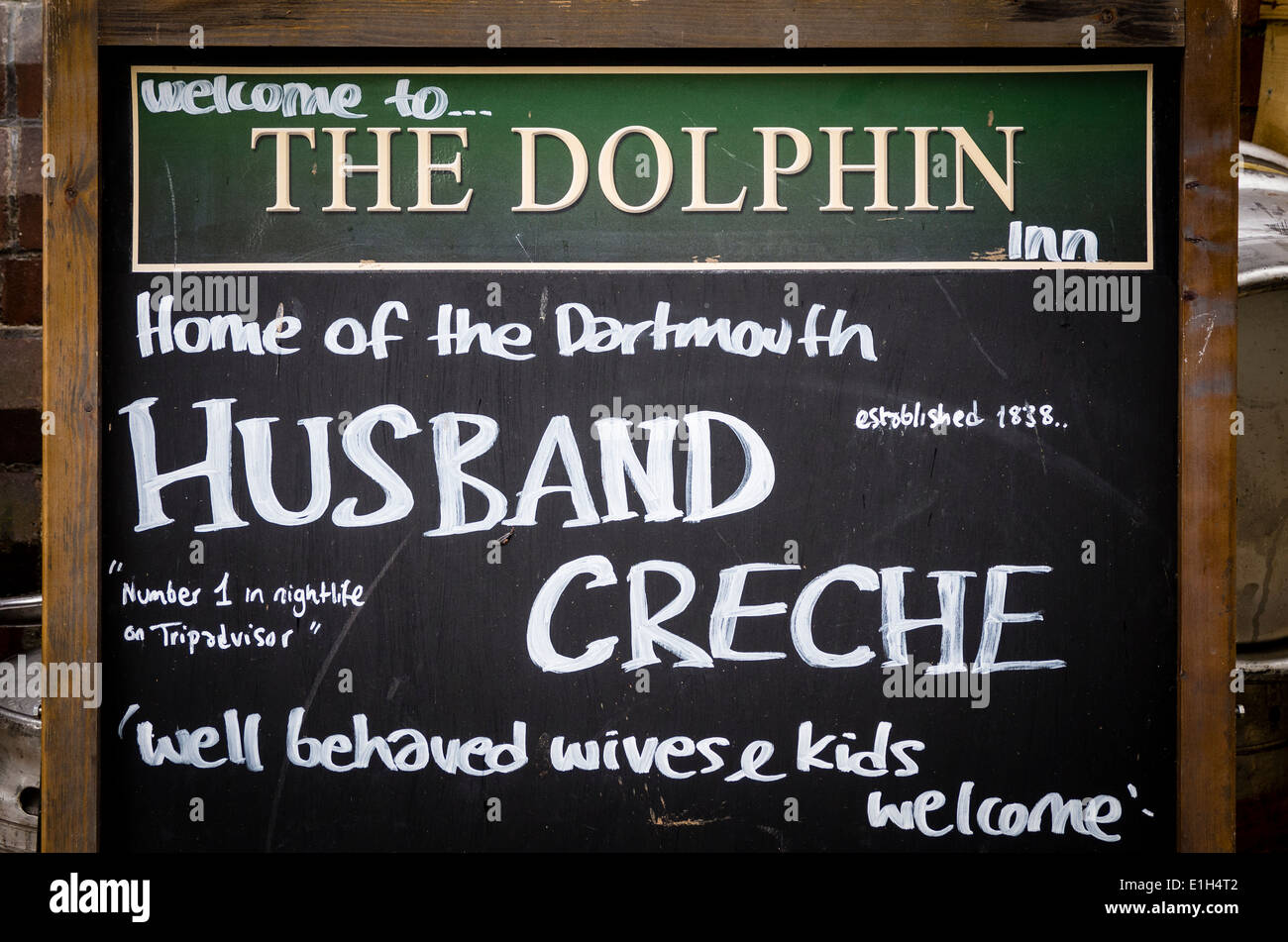 Humorous notice outside The Dolphin inn in UK - Stock Image